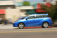 Motion Blur Blue Car. Motion blur of blue automobile speeding down highway royalty free stock photo