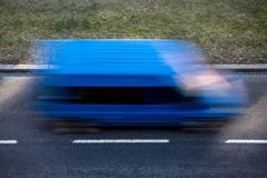 Motion blur of a blue delivery van Royalty Free Stock Photos