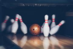 Motion blur of bowling ball skittles on the playing field royalty free stock image