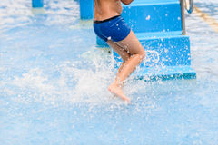 Motion blur boy running in pool. Stock Images