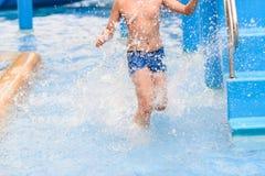 Motion blur boy running in pool. Royalty Free Stock Image