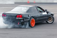 Motion blur car drifting, Professional driver drifting car on race track. stock images