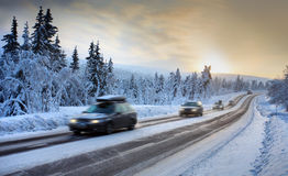 Motion Blur of Car. Driving Down Snow Covered Road Royalty Free Stock Photography