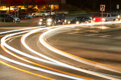 Motion Blur Of Car Headlights Turning At Busy Intersection Royalty Free Stock Photos