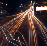 Motion blur of car lights on street at night. Stock Photos