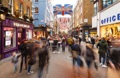 Motion blur of Christmas shoppers on Carnaby Street, London. Stock Image