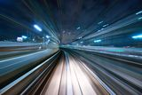 Motion Blur. Of a city and tunnel from inside a moving monorail in Tokyo Royalty Free Stock Photos