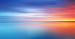 Motion blur of colorful and dramatic sunset for background. Reflection of colorful and soft sunset with long exposure effect royalty free stock images