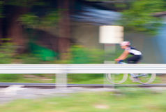 Motion blur of cyclist riding a bike Royalty Free Stock Image