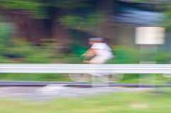 Motion blur of cyclist riding a bike Royalty Free Stock Photography