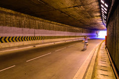 Motion blur of cyclist in underground road Royalty Free Stock Image