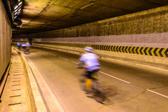 Motion blur of cyclist in underground road Royalty Free Stock Photo