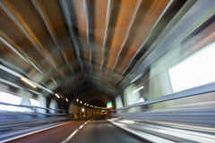 Motion Blur Driving Car at Speed Through a Tunnel Stock Photos