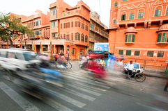 Motion blur of driving cars on the busy asian street full of cycles Royalty Free Stock Image
