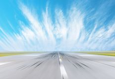 Motion blur effect speed empty runway speed at the airport taking off.  royalty free stock images