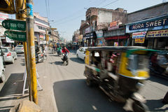 Motion blur from fast moving rickshaw on the busy street Stock Photos
