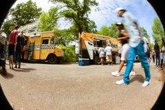 Motion Blur Fisheye Perspective Of People At Food Truck Festival Royalty Free Stock Images