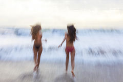 Motion Blur Girls Women Running on Beach Royalty Free Stock Photo