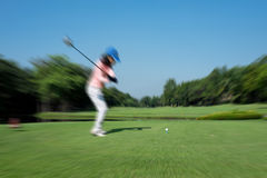 Motion blur golfer swinging driver club Stock Images