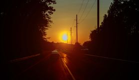 Motion blur highway traffic in sunset Road running through forest. Summer cloudscape Royalty Free Stock Photos