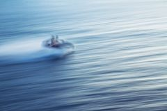 Motion blur of hydrocycle with passengers on the water stock image