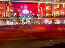 Motion blur of a London red bus on Oxford Circus at night, at Ch Stock Image