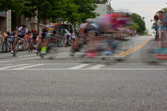 Motion Blur Of Male Cyclists Turning Corner In Amateur Race. Athens, GA, USA - April 25, 2015: Motion blur of male cyclists turning a corner in an amateur race royalty free stock photo