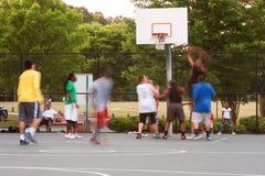 Motion Blur Men Playing Pickup Basketball Stock Image