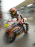 Motion blur of motorbike racer. Stock Photos