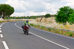 Motion Blur. Motorcycle Motion Blur on the Winding Asphalt Road in Sicily stock photography