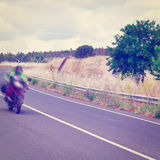 Motion Blur. Motorcycle Motion Blur on the Winding Asphalt Road in Sicily, Instagram Effect stock photos