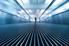 Motion blur of moving escalator in airport. Perspective view (ground level Stock Images