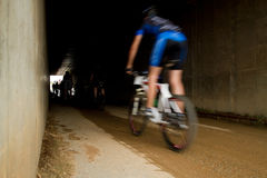 Motion blur of MTB rider entering tunnel Royalty Free Stock Photo