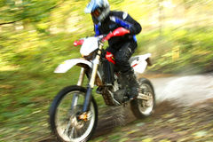 Motion blur, offroad motorbike crossing river Royalty Free Stock Photography