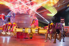 Motion Blur Of People Riding Fast Moving Carnival Ride Royalty Free Stock Photos
