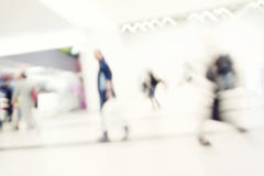 Motion blur of people in shopping mall. Intentional motion blur Stock Photos