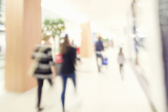 Motion blur of people in shopping mall. Intentional motion blur Royalty Free Stock Photo