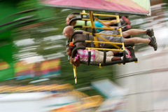 Motion Blur Of People On Speedy Carnival Ride Royalty Free Stock Image