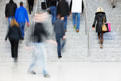 Motion Blur of People Walking on Stairs Stock Image