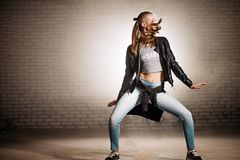 Motion blur photo of dancing girl on rock music. royalty free stock image