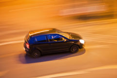 Driving car at night Stock Image