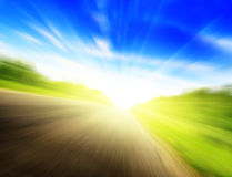 Motion blur road and sun Royalty Free Stock Photos