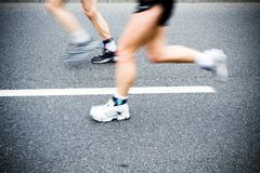 Motion blur of running man in marathon, sport shoe Stock Photos