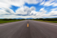 Motion blur of a rural road to infinity. From inside a moving car Royalty Free Stock Image