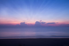 Motion blur of the sea before sunrise sky Stock Image