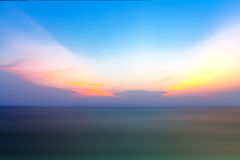 Motion blur of the sea under vivid twilight sunset sky with long Royalty Free Stock Photo