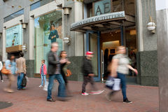 Motion Blur Of Shoppers Passing Storefront In San Francisco. San Francisco, CA, USA - October 17, 2014: Motion blur of shoppers walking by American Eagle royalty free stock images