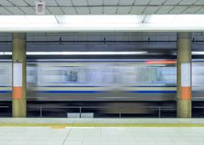 Motion blur side of high speed train in metro stock images