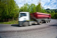 Motion blur of speeding truck Stock Image