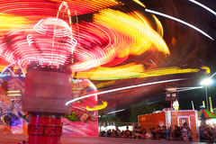 Motion Blur Of Streaking Lights From Fast Moving Carnival Ride Royalty Free Stock Images